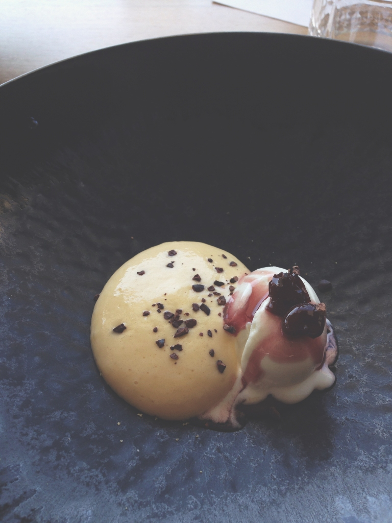 Milk ice cream, citrus sabayon, sour cherry, cocoa