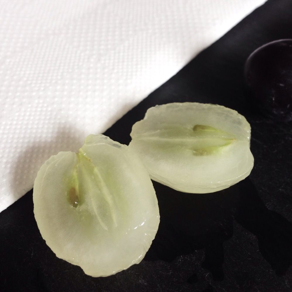 A peeled green grape.