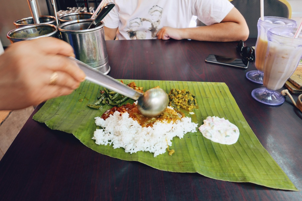 Being served banana leaf rice