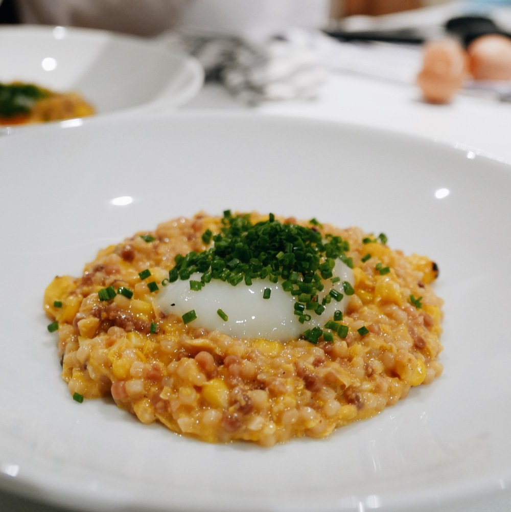Eric's fregola with homemade vegetable stock, homemade creamed corn, grilled corn, 60 degree egg, and chives